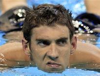 O americano Michael Phelps faz careta depois de vencer o terceiro título consecutivo nos 100 metros borboleta, em Xangai. 30/07/2011 REUTERS/Christinne Muschi