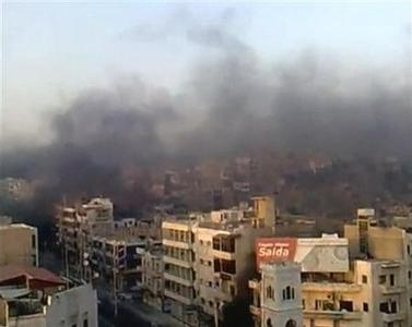 A view shows the smoke rising in the city of Hama in this still image taken from video July 31, 2011. REUTERS/YouTube via Reuters TV