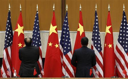 Chinese and U.S. flags are arranged during the third annual U.S.-China Strategic and Economic Dialogue (S&ED) at the State Department in Washington May 9, 2011. REUTERS/Kevin Lamarque