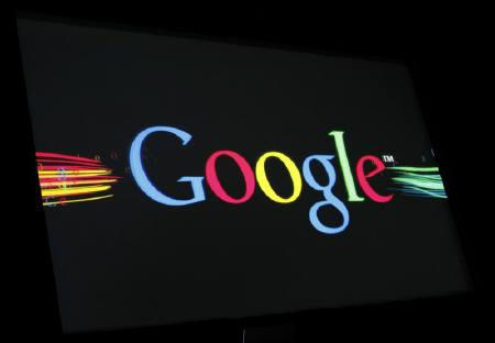 The Google Inc logo is projected on a screen during the unveiling of ''Google Instant'' at a news conference in San Francisco, California September 8, 2010. REUTERS/Robert Galbraith/Files