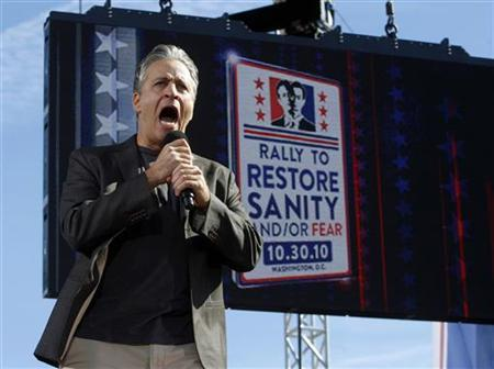 Comedian Jon Stewart addresses the crowd during his ''Rally to Restore Sanity and/or Fear'' in Washington, October 30, 2010. REUTERS/Jim Bourg
