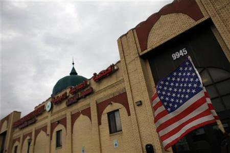An American flag hangs on a car outside the American Muslim Society mosque in Detroit, Michigan April 5, 2011. REUTERS/Eric Thayer