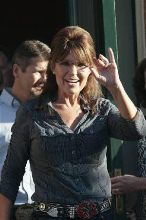 Former Alaska governor Sarah Palin waves to supporters following the premiere of a documentary about her entitled ''The Undefeated'' in Pella, Iowa June 28, 2011. REUTERS/Brian C. Frank/Files