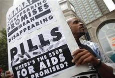 <p>An AIDS activist holds a sign while demonstrating near the site of the G20 Pittsburgh Summit against the policies of the world's wealthiest nations regarding AIDS research and treatment funding in Pittsburgh, Pennsylvania September 22, 2009. REUTERS/Eric Thayer</p>
