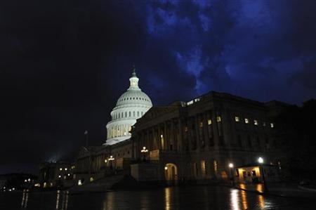 Storm clouds gather above the U.S. Capitol in Washington July 11, 2011. Lawmakers from both parties are under pressure to find a solution to a looming U.S. debt default crisis. REUTERS/Jonathan Ernst