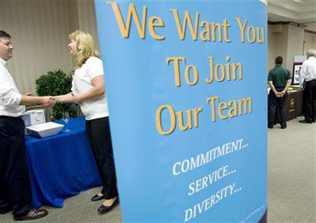 Jobseekers attend a ''Hiring our Heroes'' job fair aimed at out-of-work military veterans, sponsored by the Loudoun County Chamber of Commerce in Ashburn, Virginia, July 12, 2011. REUTERS/Jonathan Ernst