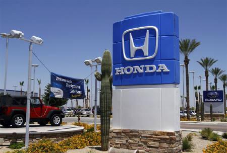 A Honda sign is displayed outside SanTan Honda Superstore in Chandler, Arizona June 2, 2011. REUTERS/Joshua Lott