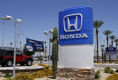 A Honda sign is displayed outside SanTan Honda Superstore in Chandler, Arizona June 2, 2011. REUTERS/Joshua Lott