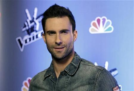 Singer Adam Levine poses during a media event for the upcoming television series ''The Voice'' in Los Angeles March 15, 2011. REUTERS/Mario Anzuoni