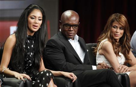Nicole Scherzinger (L), L.A. Reid (C), and Paula Abdul, judges on new talent show 'The X Factor', speak during a panel session at the FOX Summer TCA Press Tour in Beverly Hills, California August 5, 2011. REUTERS/Fred Prouser