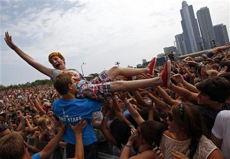 A music fan crowd surfs during a performance by ''Foster the People'' at the Lollapalooza music festival in Grant Park in Chicago, August 5, 2011. REUTERS/Jim Young