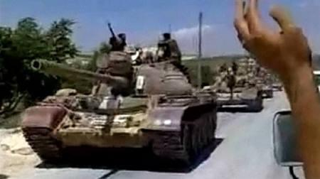 Military tanks drive into the Jabal Al-Zawya area of Idlib on August 1, 2011 in this still image taken from video posted on a social media website.   REUTERS/Social Media Website via Reuters TV/EDITOR'S NOTE: REUTERS CANNOT INDEPENDENTLY VERIFY CONTENT VIDEO FROM WHICH THIS STILL IMAGE WAS TAKEN
