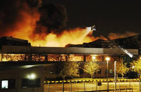Fire destroys a Sony warehouse in Enfield in north London August 9, 2011. REUTERS/Luke MacGregor