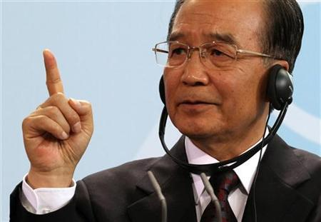 China's Premier Wen Jiabao gestures as he addresses a news conference with German Chancellor Angela Merkel at the Chancellery in Berlin, June 28, 2011. REUTERS/Fabrizio Bensch