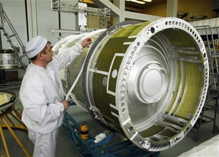 An engineer works on the GLONASS-M-33 space satellite in the assembly area of the open joint-stock company Reshetnev Information Satellite Systems (formerly known as the NPO PM Applied Mechanics Institute) in the Siberian town of Zheleznogorsk, 50 km (31 miles) northeast of the city of Krasnoyarsk, April 8, 2009. REUTERS/Ilya Naymushin