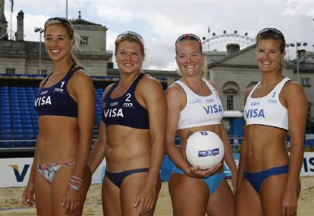Britain's beach volleyball team members Denise Johns, Lucy Bolton, Shauna Mullin and Zara Dampney (L-R) pose the day before the FIVB Beach Volleyball test event for the London 2012 Olympic Games at Horse Guards Parade in London August 8,  2011.    REUTERS/Luke MacGregor