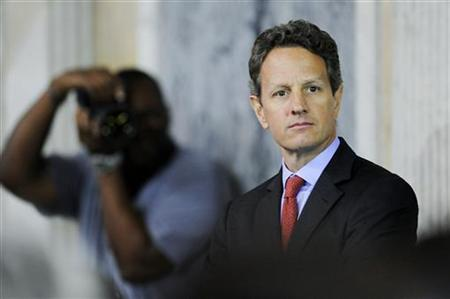 U.S. Treasury Secretary Timothy Geithner waits to go onstage at the Women in Finance Symposium at the Treasury Department in Washington, July 12, 2011. REUTERS/Jonathan Ernst