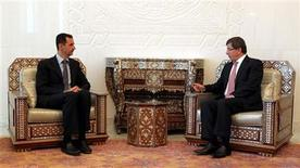 Syria's President Bashar al-Assad (L) meets with Turkish Foreign Minister Ahmet Davutoglu in Damascus August 9, 2011. REUTERS/Turkish Foreign Ministry/Hakan Goktepe/Handout