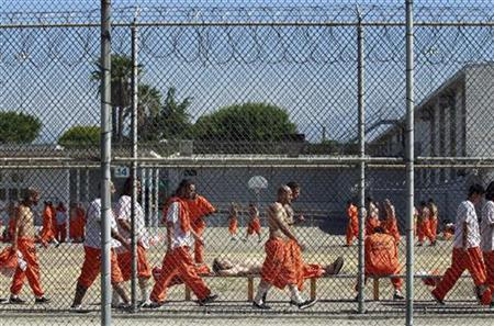 Inmates walk around an exercise yard at the California Institution for Men state prison in Chino, California, June 3, 2011. REUTERS/Lucy Nicholson