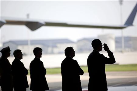 U.S. President Barack Obama salutes during a ceremony for the ''dignified transfer'' of U.S. and Afghan personnel who died in a helicopter crash in Afghanistan, at Dover Air Force Base in Dover, Delaware, August 9, 2011. REUTERS/Pete Souza/The White House/Handout