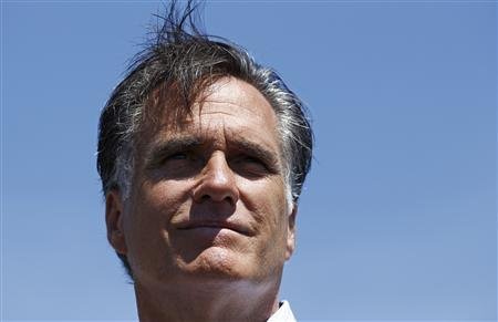 U.S. Republican presidential candidate and former Massachusetts Governor Mitt Romney speaks to reporters in Pella, Iowa, August 10, 2011. REUTERS/Jim Young