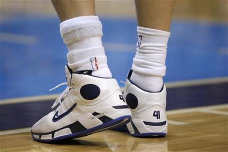 A brace is seen on Dallas Mavericks Dirk Nowitzki's ankle during second half NBA action against the Golden State Warriors in Dallas, Texas April 2, 2008. REUTERS/Jessica Rinaldi