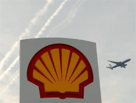 A Shell logo is seen at a petrol station in London April 28, 2010. REUTERS/Toby Melville/Files