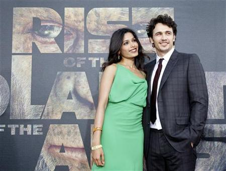 Cast members James Franco and Freida Pinto pose at the premiere of ''Rise of the Planet of the Apes'' at the Grauman's Chinese theatre in Hollywood, California July 28, 2011. REUTERS/Mario Anzuoni