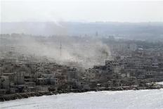 <p>Smoke rises in the city of Latakia August 14, 2011. REUTERS/Handout</p>