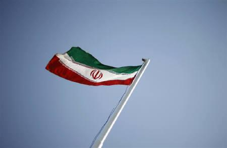 An Iranian national flag flutters in Tehran April 15, 2011. REUTERS/Morteza Nikoubazl/Files