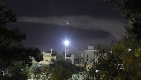Smoke rises in the sky after an explosion was heard in eastern Tripoli August 14, 2011. REUTERS/Paul Hackett