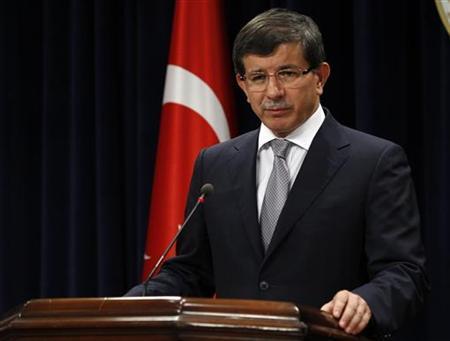 Turkish Foreign Minister Ahmet Davutoglu addresses the media in Ankara August 15, 2011. REUTERS/Umit Bektas