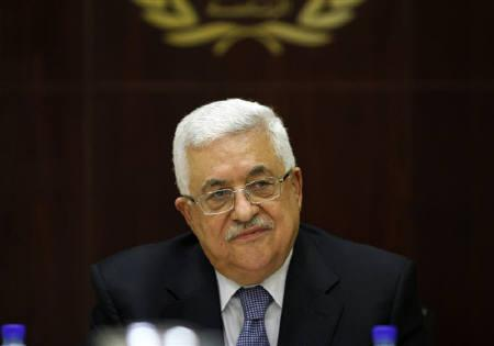 Palestinian President Mahmoud Abbas attends a meeting in Ramallah July 26, 2011. bbas said on Tuesday the Palestinians will apply for full U.N. membership at September's meeting of the U.N. General Assembly, confirming the timing of a step opposed by the United States and Israel. REUTERS/Mohamad Torokman/Files