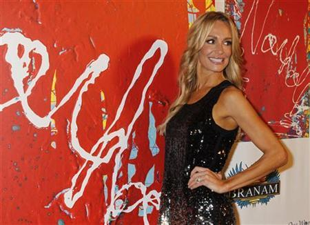 Taylor Armstrong, from the Bravo reality TV series 'The Real Housewives of Beverly Hills', arrives at the unveiling of artist Jack Armstrong's 'Cosmic Starship' Harley-Davidson motorcycle at Bartels Harley-Davidson in Marina Del Rey, California October 21, 2010. REUTERS/Fred Prouser