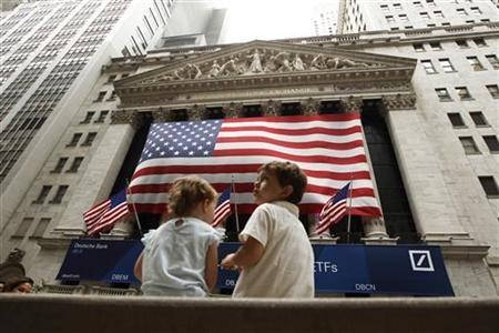 Two children sit on a bench outside the New York Stock Exchange August 9, 2011. REUTERS/Lucas Jackson
