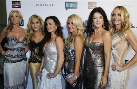 The cast of Bravo's reality series ''The Real Housewives of Beverly Hills'' Camille Grammer, Adrienne Maloof, Kyle Richards, Kim Richards, Lisa Vanderpump and Taylor Armstrong (L-R) pose at the premiere party in Los Angeles October 11, 2010. REUTERS/Fred Prouser/Files