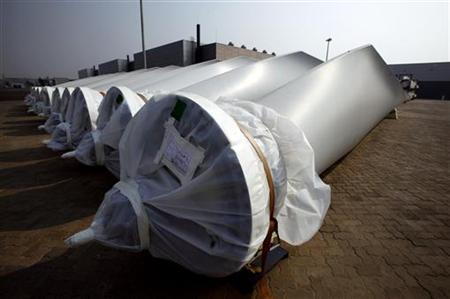 Blades for wind-turbines can be seen in the grounds of the Vestas Wind Technology company's factory, located in the northern Chinese city of Tianjin September 14, 2010. REUTERS/David Gray
