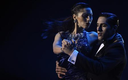 Tango dancers Leonardo Luizaga (R) and Paola Luizaga of Argentina compete in the stage category of Argentina's eighth edition of the Tango Dance World Championship in Buenos Aires, August 31, 2010. REUTERS/Marcos Brindicci