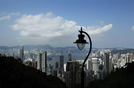 The skyline of downtown Hong Kong and the Victoria Harbour is seen from the Peak July 7, 2011.   REUTERS/Bobby Yip