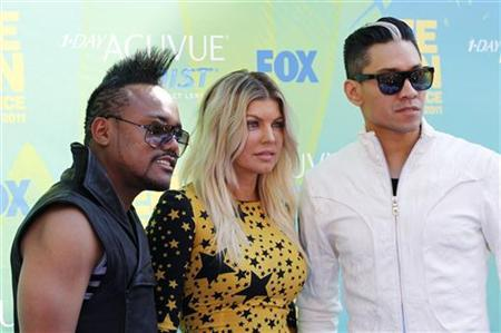 Apl.de.ap.,(L-R) Fergie, and Taboo, from the Black Eyed Peas, pose together at the Teen Choice Awards in Los Angeles August 7, 2011. REUTERS/Danny Moloshok
