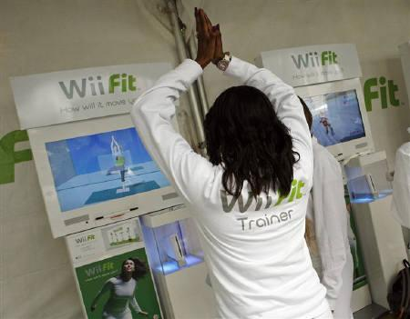 A woman demonstrates an interactive yoga game on Nintendo's Wii Fit, in New York May 19, 2008.     REUTERS/Shannon Stapleton/Files