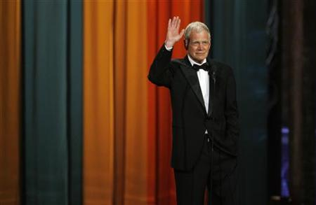 Late night television host David Letterman waves to the crowd as he accepts The Johnny Carson Award for Comedic Excellence at ''The Comedy Awards'' in New York City March 26, 2011. REUTERS/Jessica Rinaldi