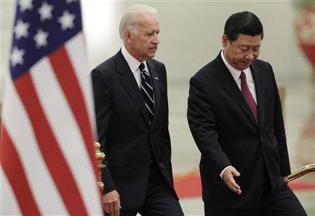 Vice President Joe Biden (L) is ushered to the podium by his Chinese counterpart Xi Jinping during a welcome ceremony at the Great Hall of the People in Beijing August 18, 2011. REUTERS/How Hwee Young/Pool