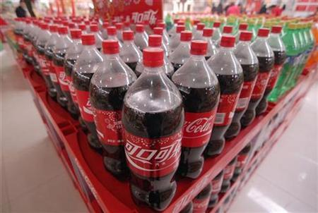 Bottles of Coca-Cola are seen on sale at a supermarket in Xiangfan, Hubei province March 19, 2009. REUTERS/Stringer