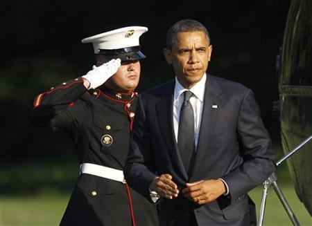 U.S. President Barack Obama returns to the White House in Washington, August 9, 2011, following his trip to Dover Air Force Base where he attended a ceremony honouring the return of U.S. Servicemen remains following a helicopter crash in Afghanistan. REUTERS/Jason Reed
