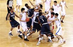 <p>Players from American Georgetown University men's basketball team and China's Bayi men's basketball team fight during a basketball friendly game at the Beijing Olympic Basketball Arena August 18, 2011. REUTERS/China Daily</p>