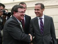 <p>Canada's Finance Minister Jim Flaherty (L) shakes hands with Bank of Canada Governor Mark Carney during a break in testimony at the House of Commons finance committee on Parliament Hill in Ottawa August 19, 2011. REUTERS/Chris Wattie</p>
