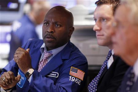 Traders work on the floor of the New York Stock Exchange August 19, 2011. REUTERS/Lucas Jackson
