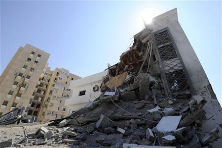 EDITOR'S NOTE: PICTURE TAKEN ON A GUIDED GOVERNMENT TOUR. A building Libyan officials described as a civil engineering office lies flattened after being bombed overnight by NATO in Tripoli, August 20, 2011. REUTERS/Paul Hackett