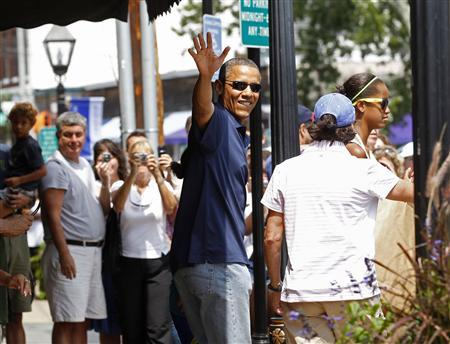U.S. President Barack Obama walks out of the Bunch O Grapes bookstore after shopping with his daughters in Vineyard Haven on Martha's Vineyard in Massachusetts August 19, 2011. REUTERS/Kevin Lamarque